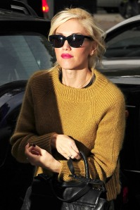 A solo Gwen Stefani sports a mustard sweater and camo trousers while out and about in London