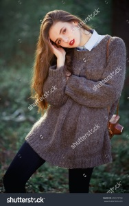 stock-photo-young-beautiful-girl-with-long-brown-hair-expressive-cheekbones-free-warm-sweater-and-pants-with-a-403574758